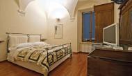 Camera da letto di un lussuoso B&B in centro a Siena