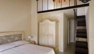 Camera da letto con soppalco